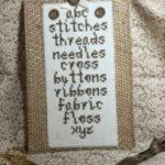 cross stitcher's sampler in brown thread