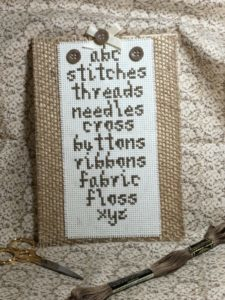 cross stitcher's sampler in brown thread