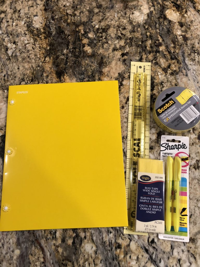 yellow folder and supplies